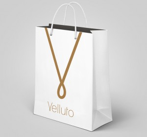 <span>Velluto Fashion</span><i>→</i>